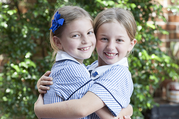 McAuley Catholic Primary School Rose Bay - students hugging each other