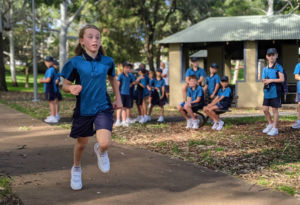 Student from St Aloysius Cronulla running cross country